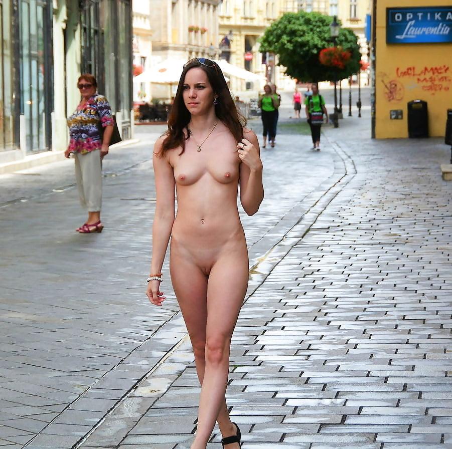 Naked girl walking on railroad tracks