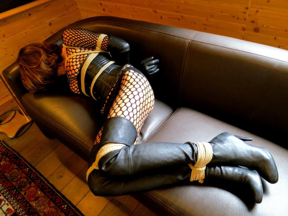 Gay male leather bondage