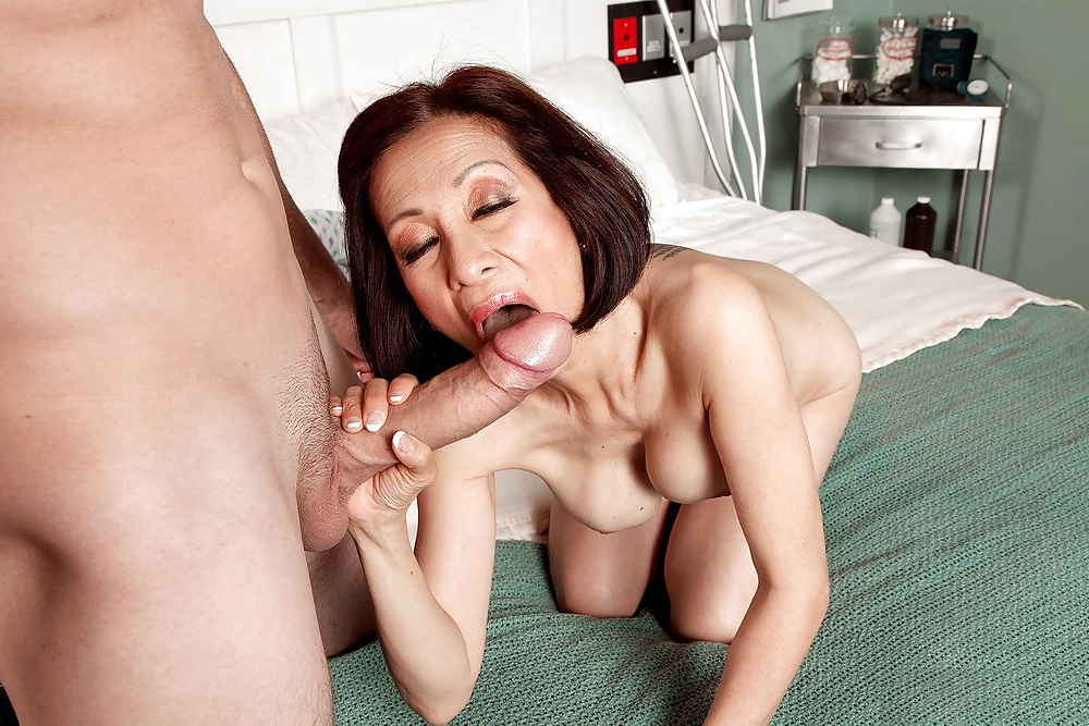 Slender asian milf with nice tits loves them young and horny photo