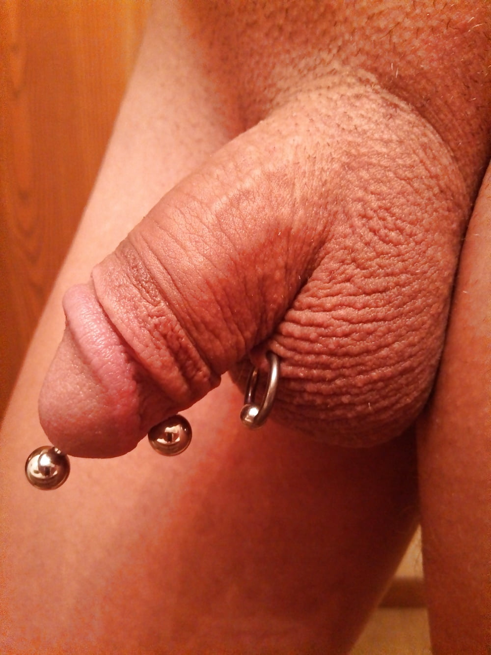Hairy dad plays with his pierced cock