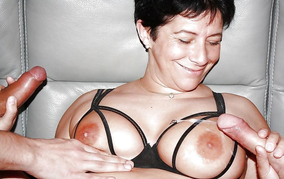 Hot german milf big boobs leather outfit giving teasing handjob tnaflix porn pics