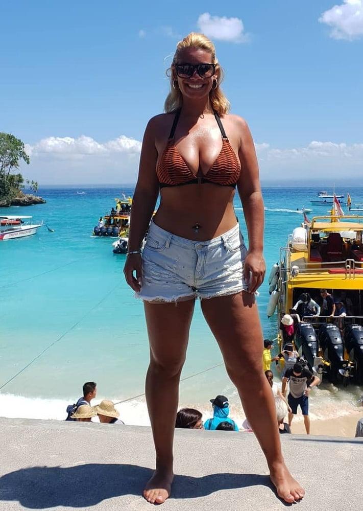 Amateur Dutch nurse Cheryl with huge tits in bikini - 63 Pics