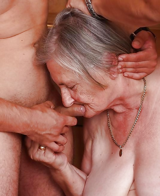 Grandma sucks and fucks a big black dildo