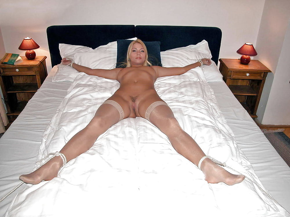 Mature wife tied spread eagle — img 1