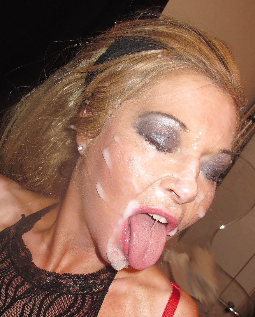 Smiling blonde milf with cum all over her face