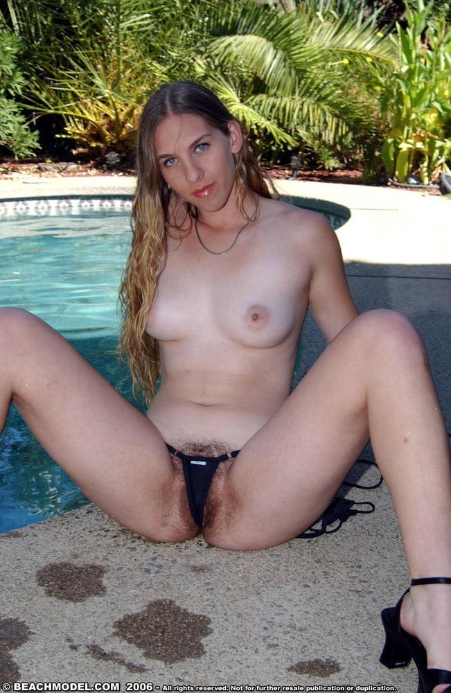 Bikini wearing beauty rubbing hairy pussy and seducing herself