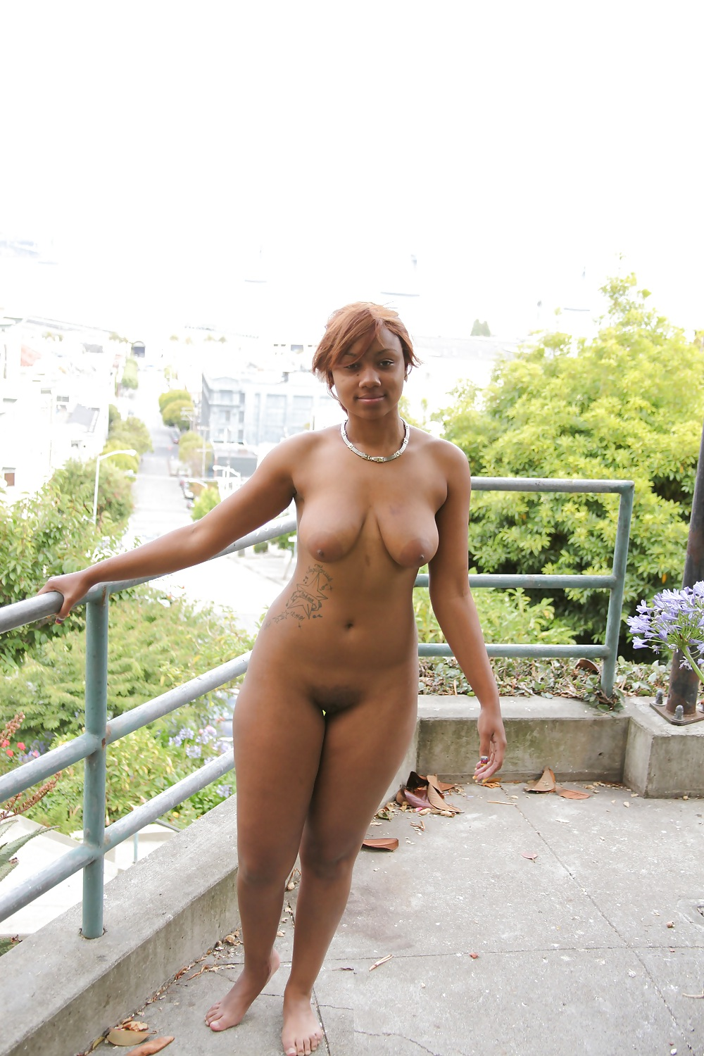 Nude ebony in public