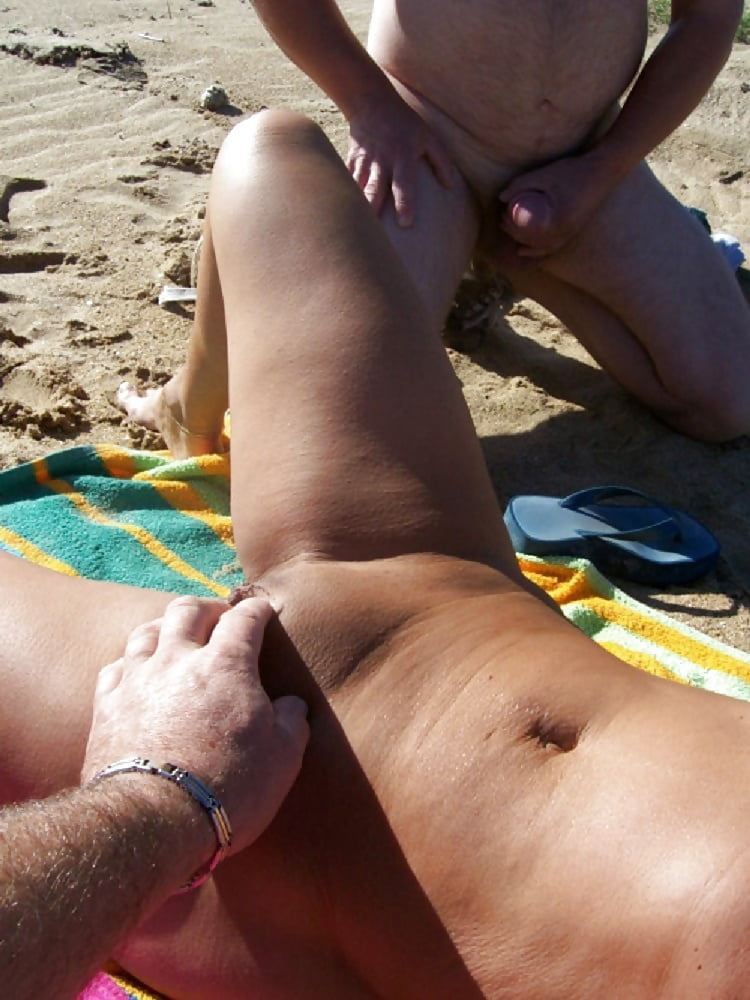 sleeping-women-get-flash-cum-on-the-nude-beach