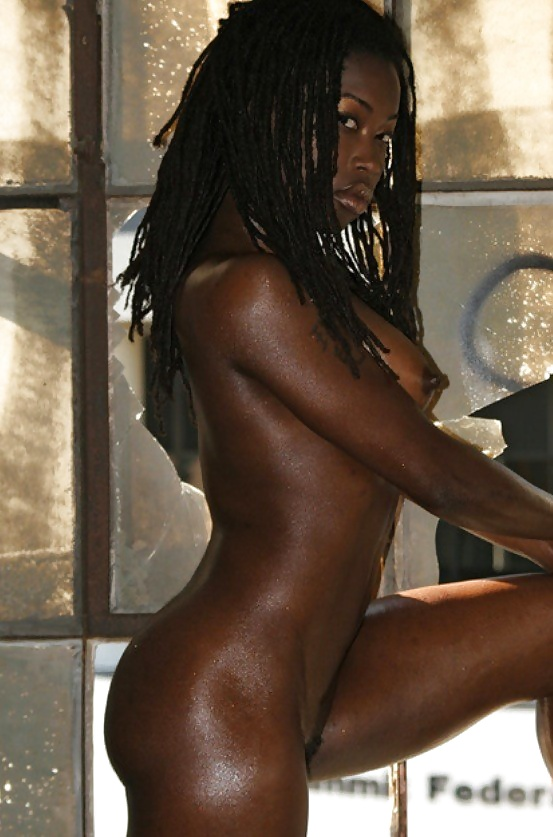 Naked dark skinned girl in the shower that