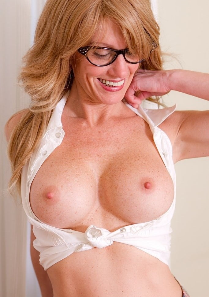 Blonde milf with glasses, sexy naked striping