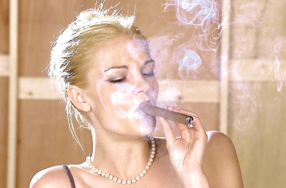 Mature blonde smoking a cigar point of view