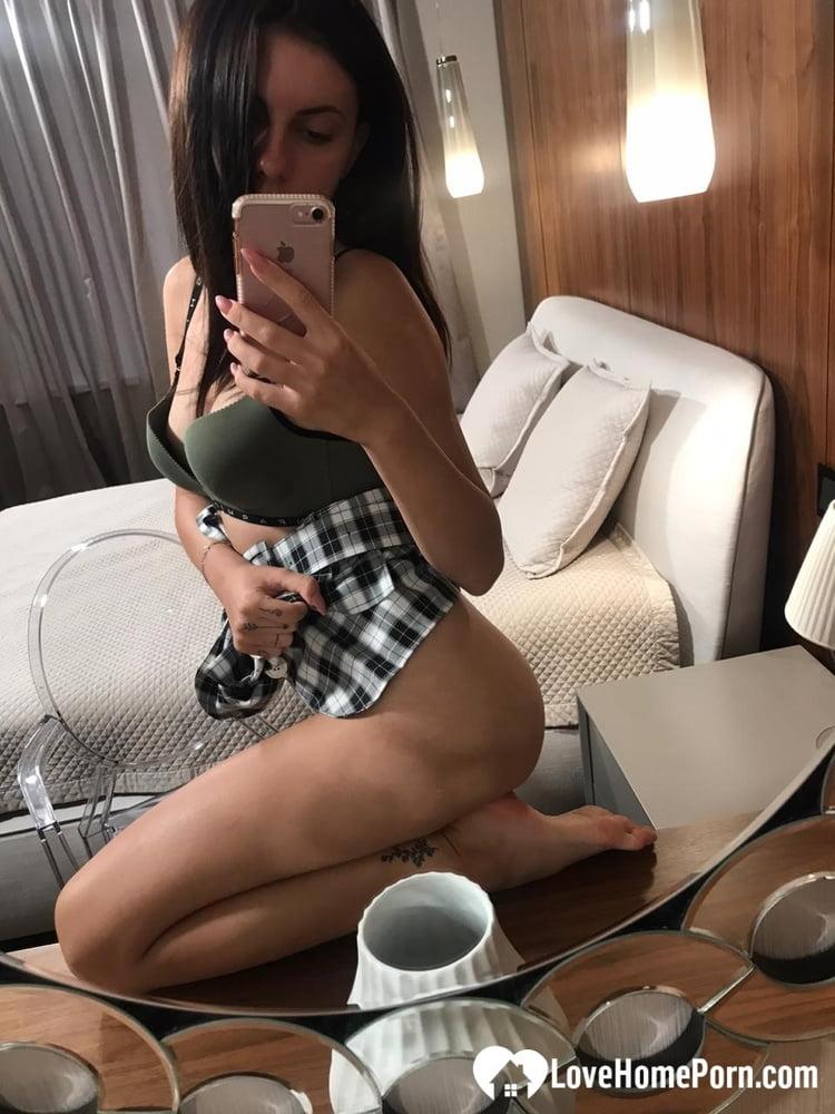 Hot schoolgirl reveals her tits in the mirror - 26 Pics