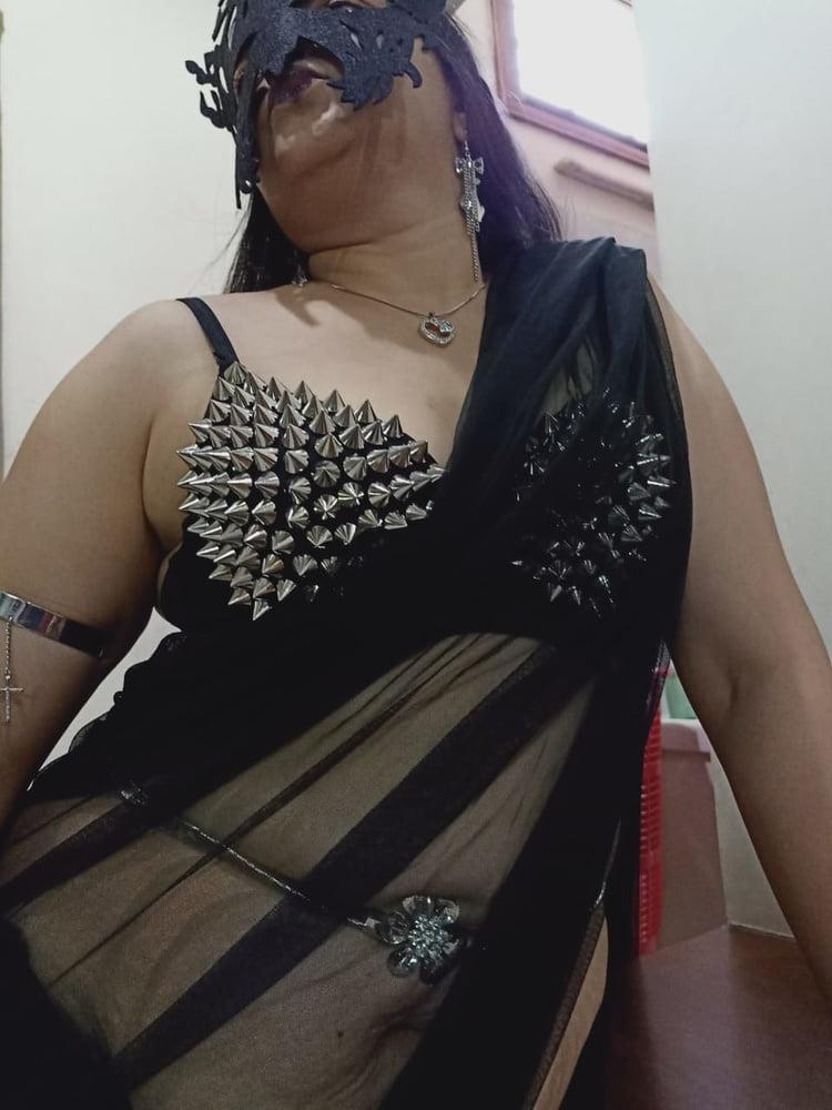 Black saree- 8 Pics