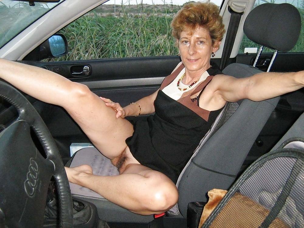 Sex mature under car photo