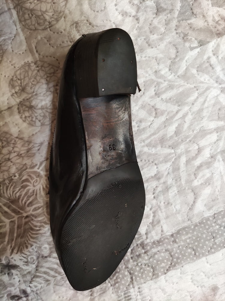 Worn shoe found in the street and cummed