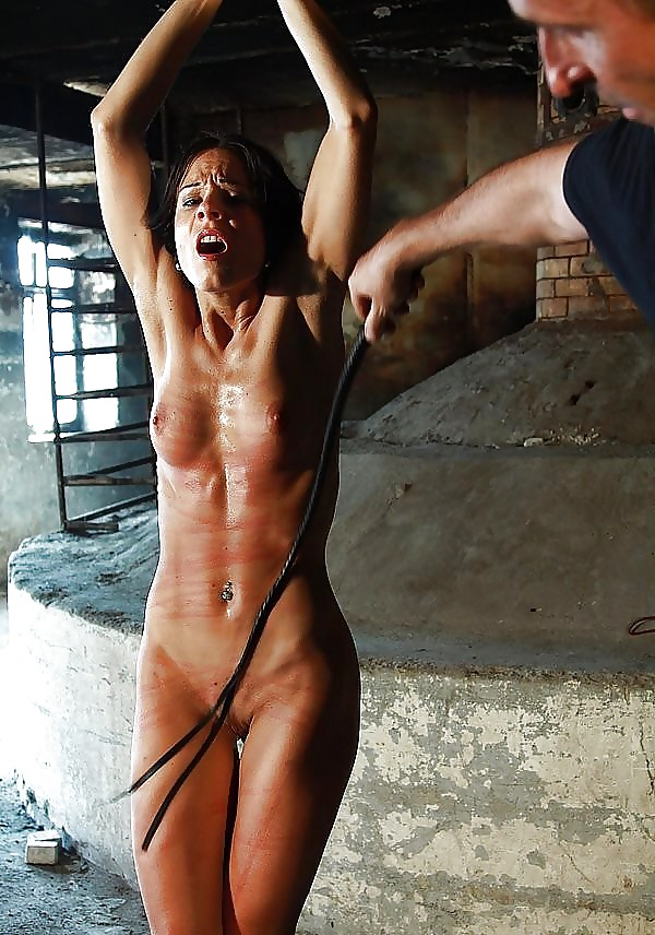 Nude Teen Girl Is Standing Still While Torturer Is Wrapping Whip Around Her Waist