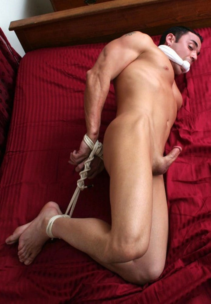 Twink fucked hard by two dudes while completely tied up