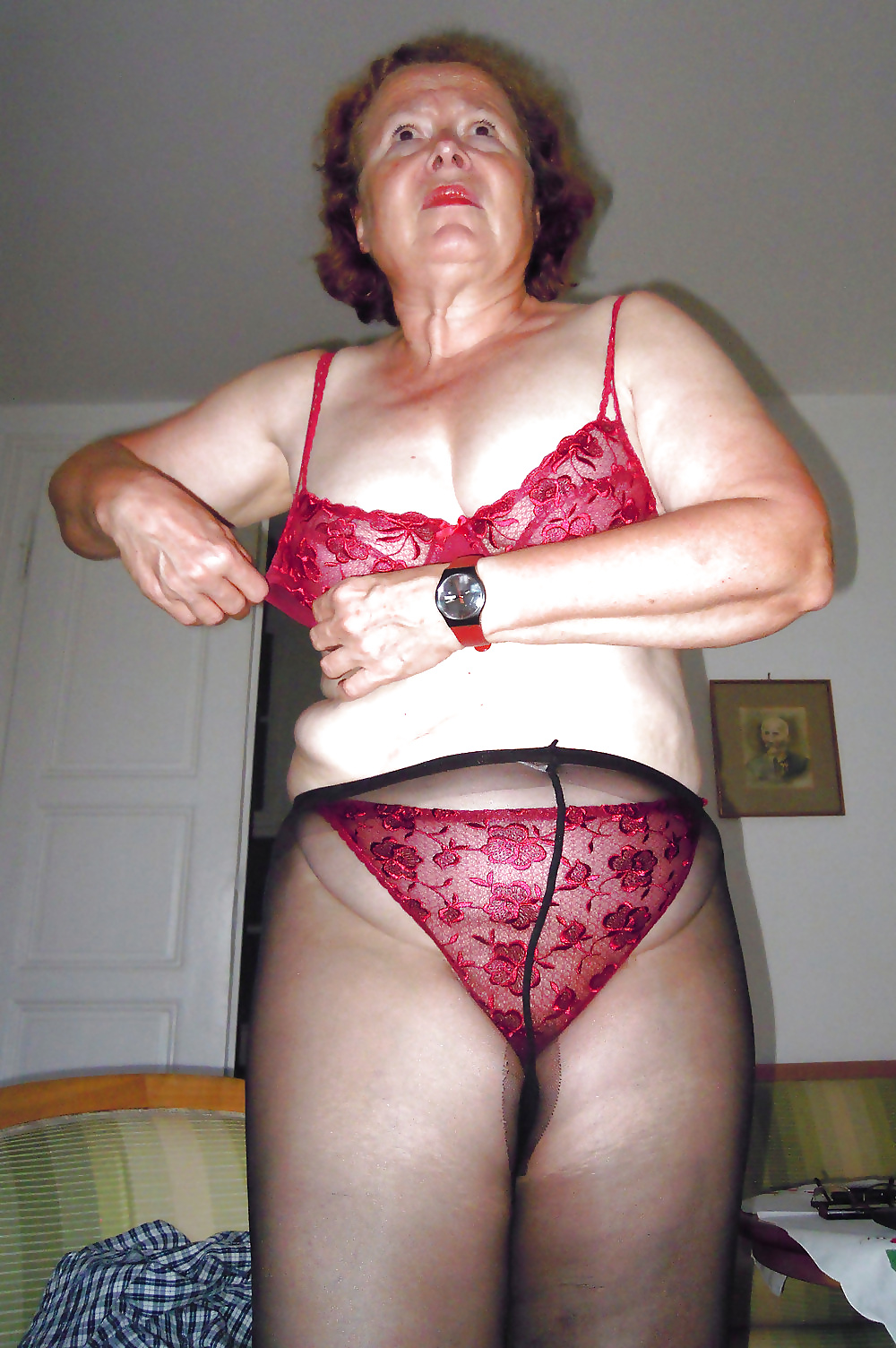Granny's bras removed to reveal huge titties