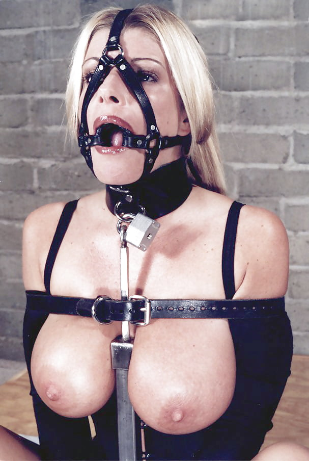 Midget race dribbling with a gag in bondage