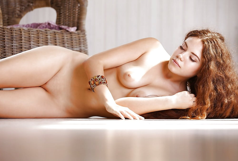 Hot young perky tit brunette with long curly hair loves