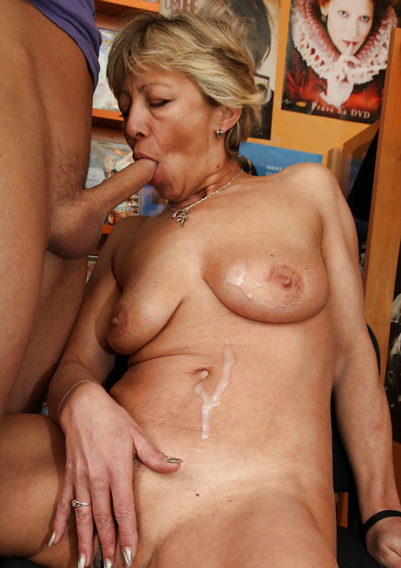 Mature wife visits adult sex store