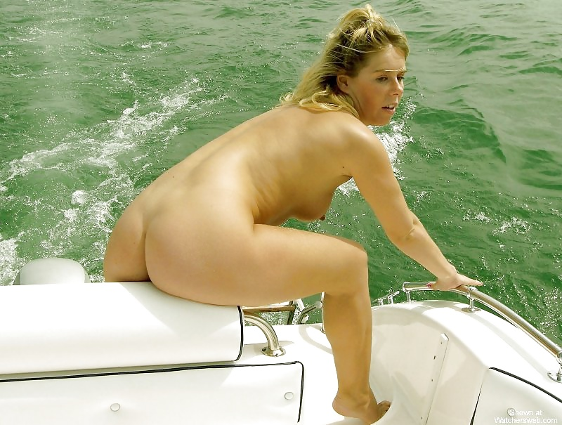 Naked girls in a boat