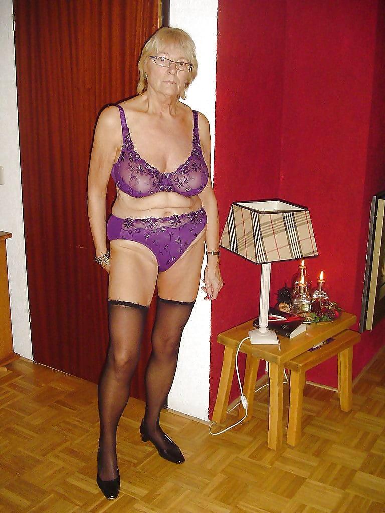 Beautiful mature blonde woman wearing underwear