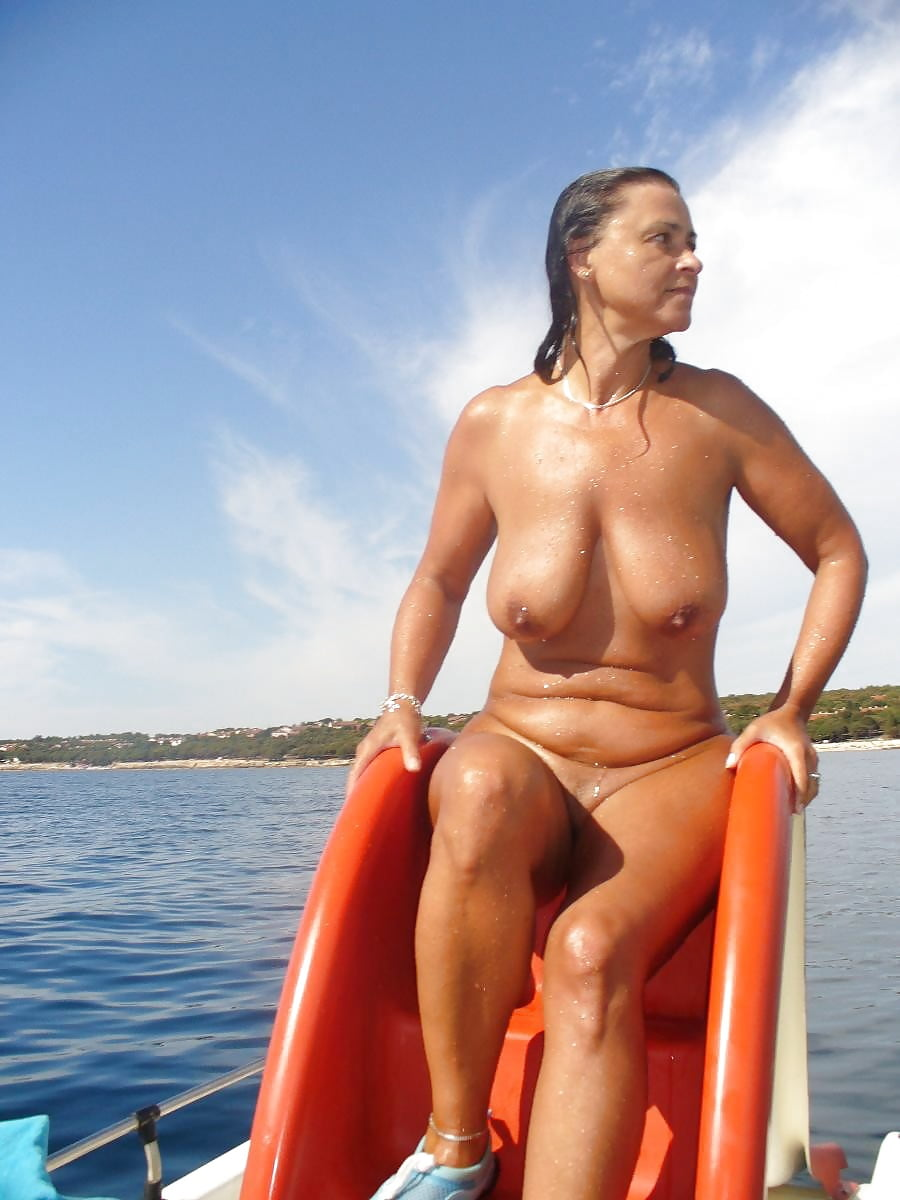 Mature wife nude on boat