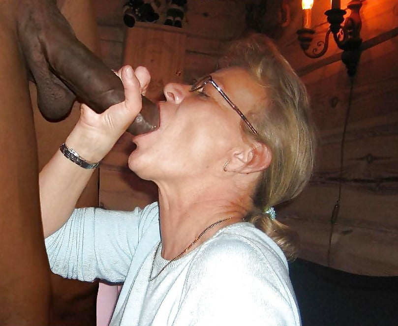 Two lustful mature women have a cock sucking contest