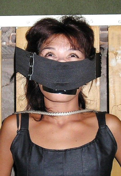 Naked women tied up and gagged