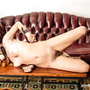 A lovely girl with unshaved pussy chained on the table