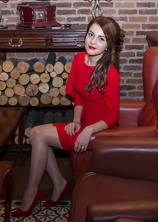 young russian wife in red dress and pantyhose