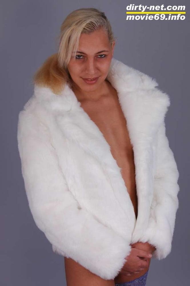 Teen Nathalie just wearing fur, stockings and high heels - 14 Pics