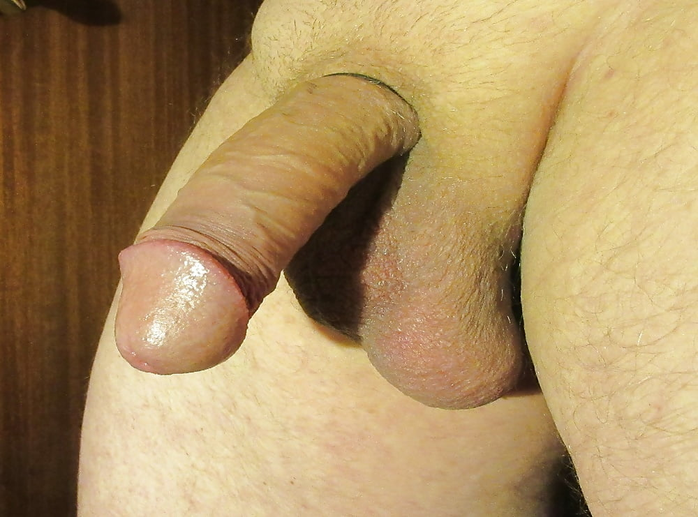 Nude guy with a small soft cock