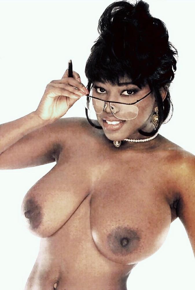 Busty Ebony Strapon Orgy