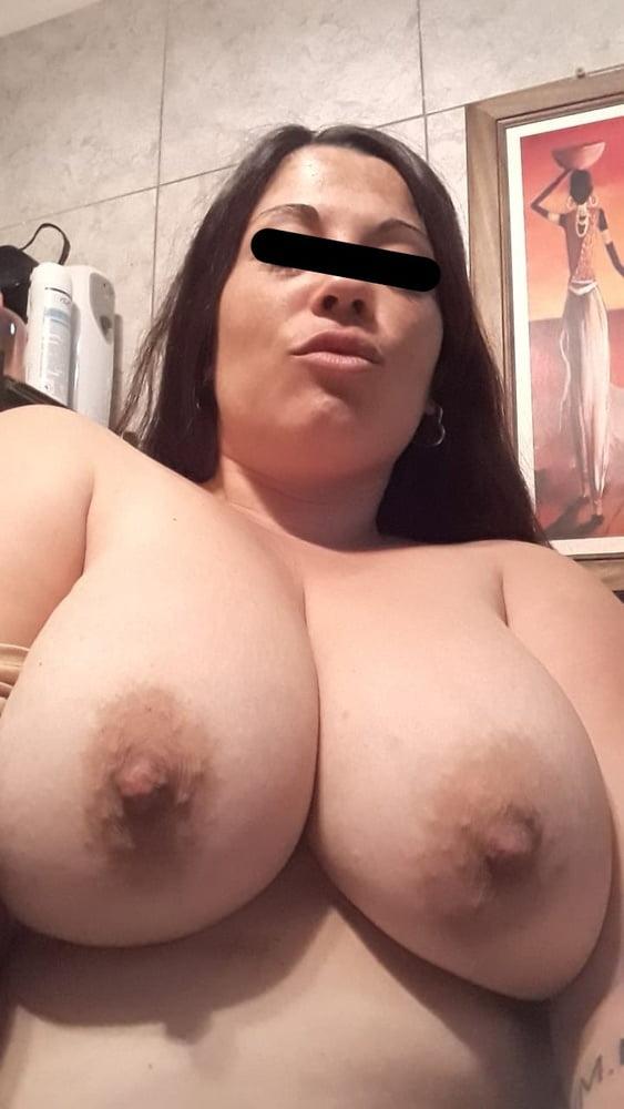 Sexy latina strokes a big cock