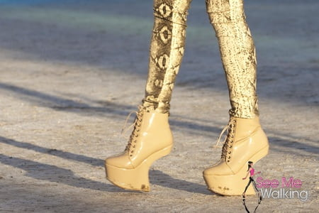 girl in high platform shoes and leather leggins long legs