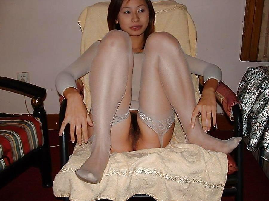 Chinese slut in stockings — photo 14