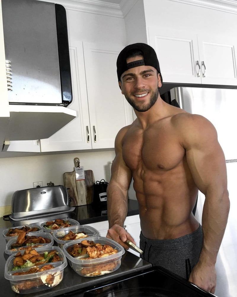 Naked guy cooking stock photo footage