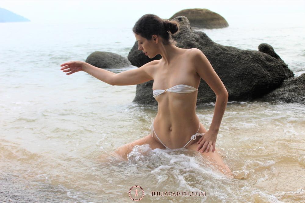 Part 3. Julia V Earth in white bikini at the beach. - 10 Pics