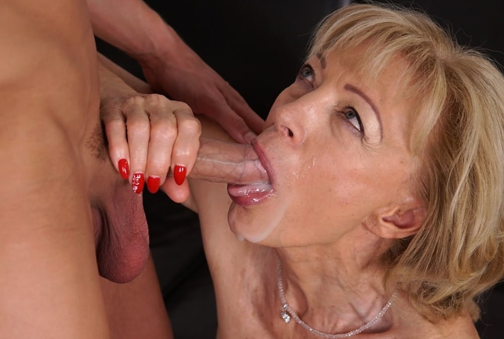 Pervert Grandma In Latex Giving A Blowjob Picture