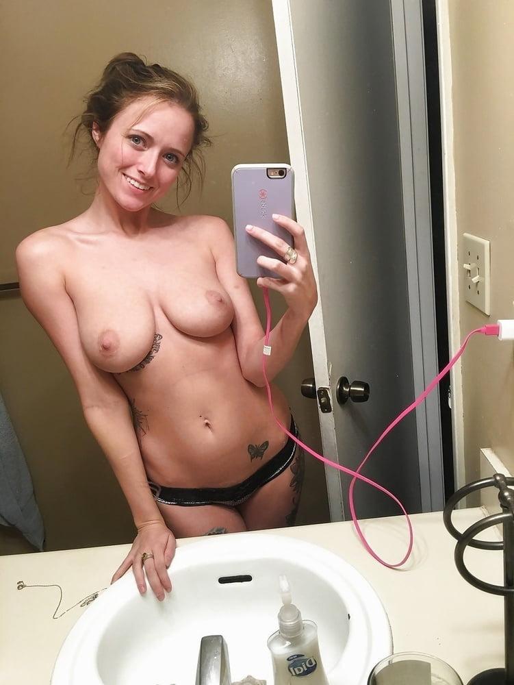 Self took in mirror nude photos