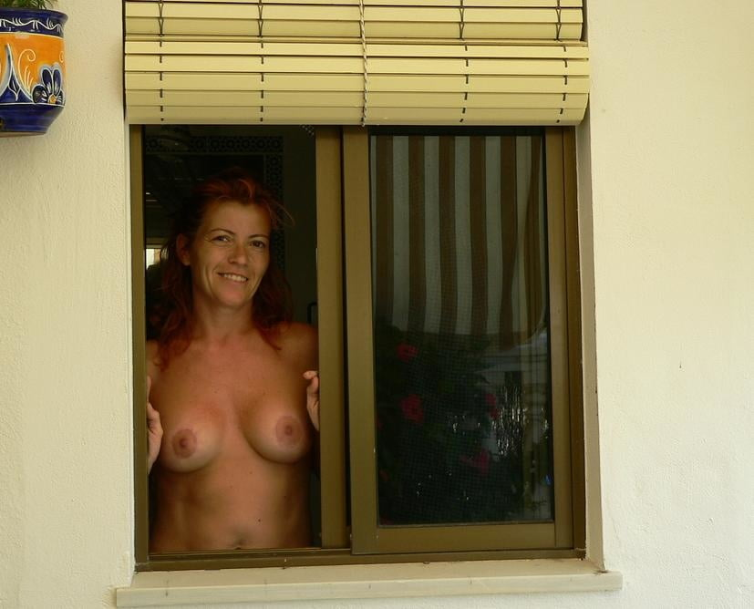 Nude woman voyeur window