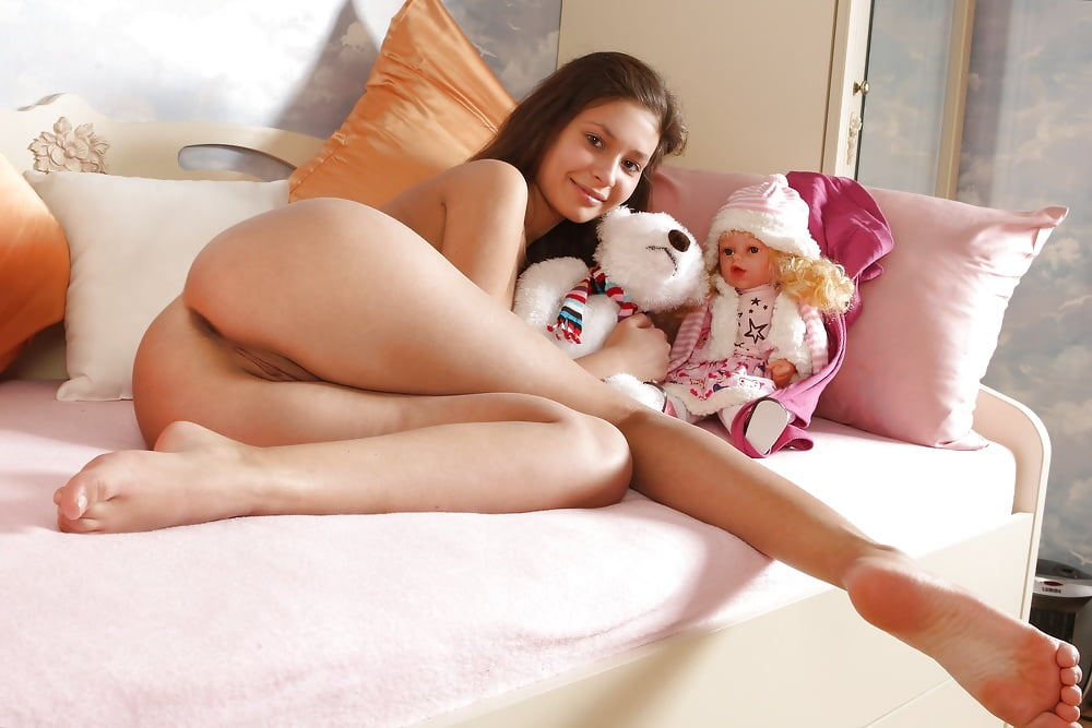 Cute Naked Girl With A Toy