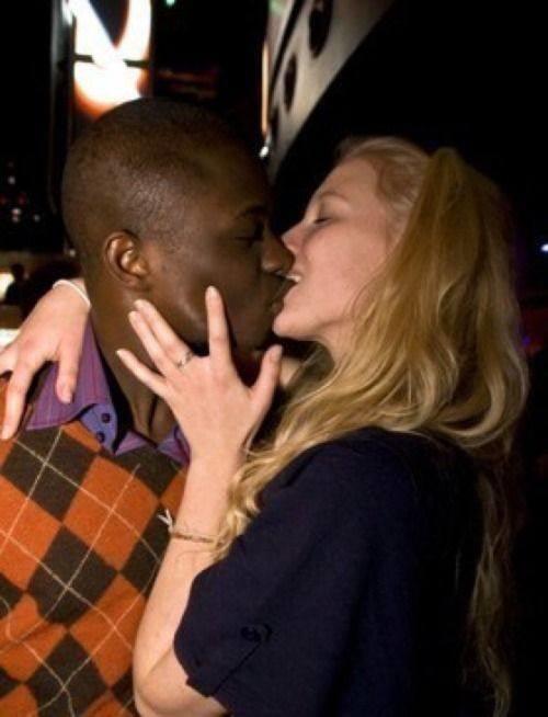 white woman kisses black man s feet