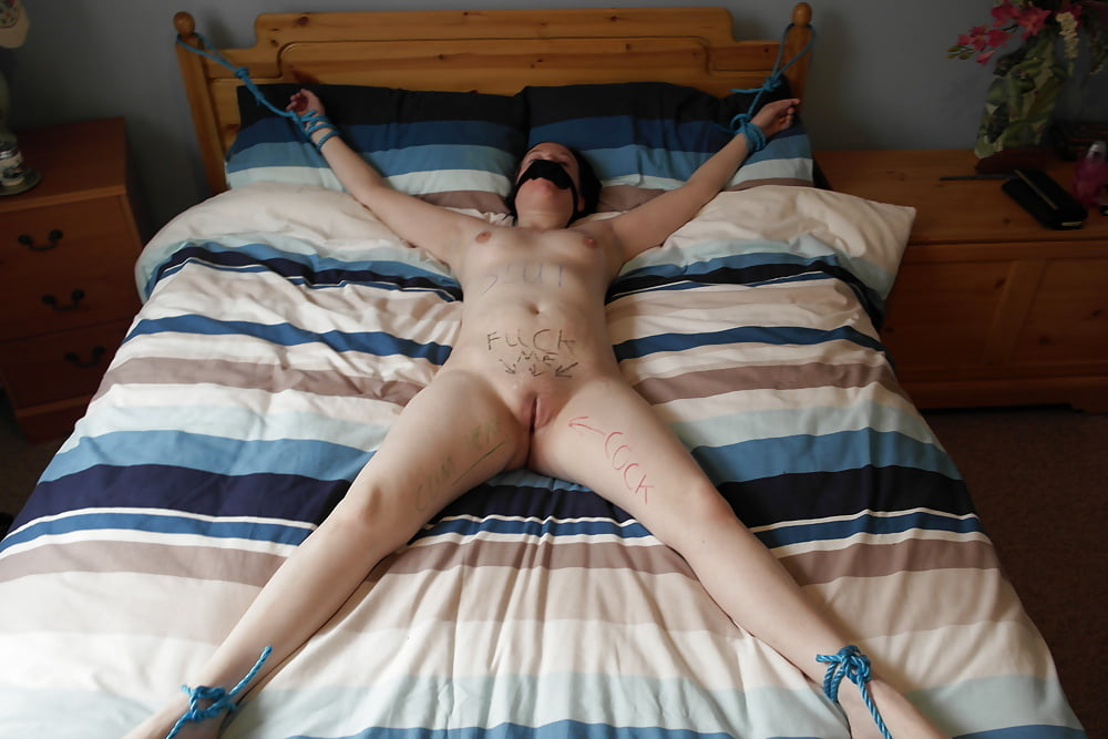 Slut is tied up with rope on the bed