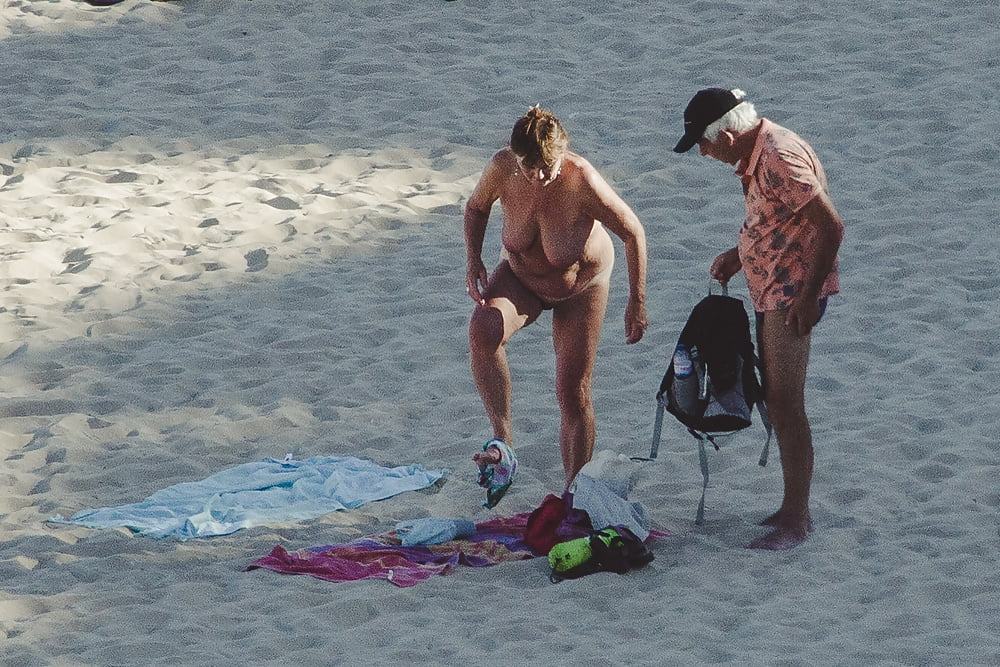 Naked old men on the beach-7445