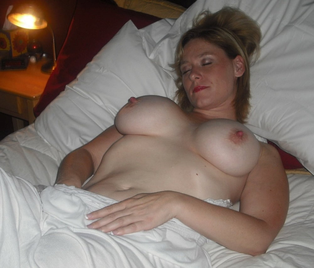 Naughty son images his sleeping mom's big tits