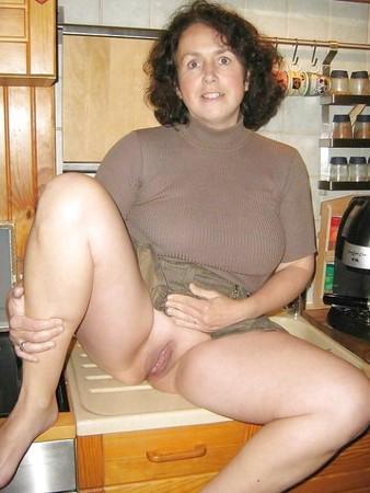 Nude mature women posing