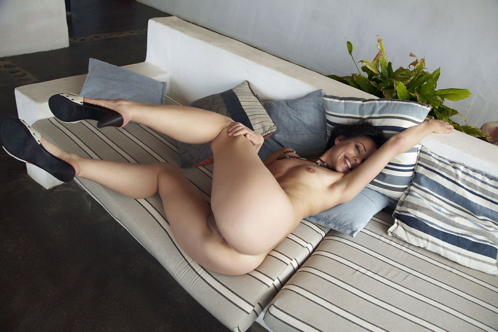 Wife poses on the sofa for pics